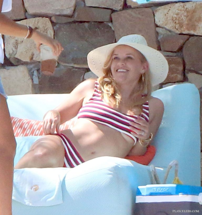 Reese Witherspoon Flashes Underboobs While Tanning In Bikini