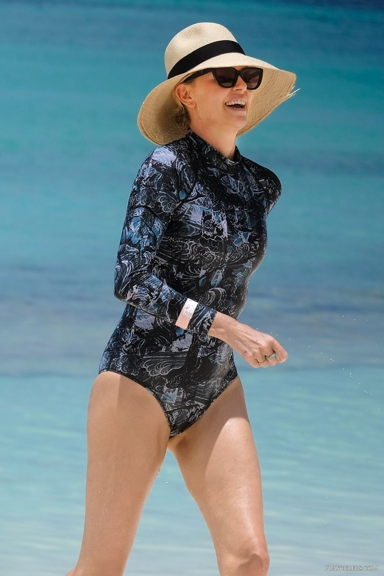 Charlize Theron Caught By Paparazzi In Swimsuit On A Beach