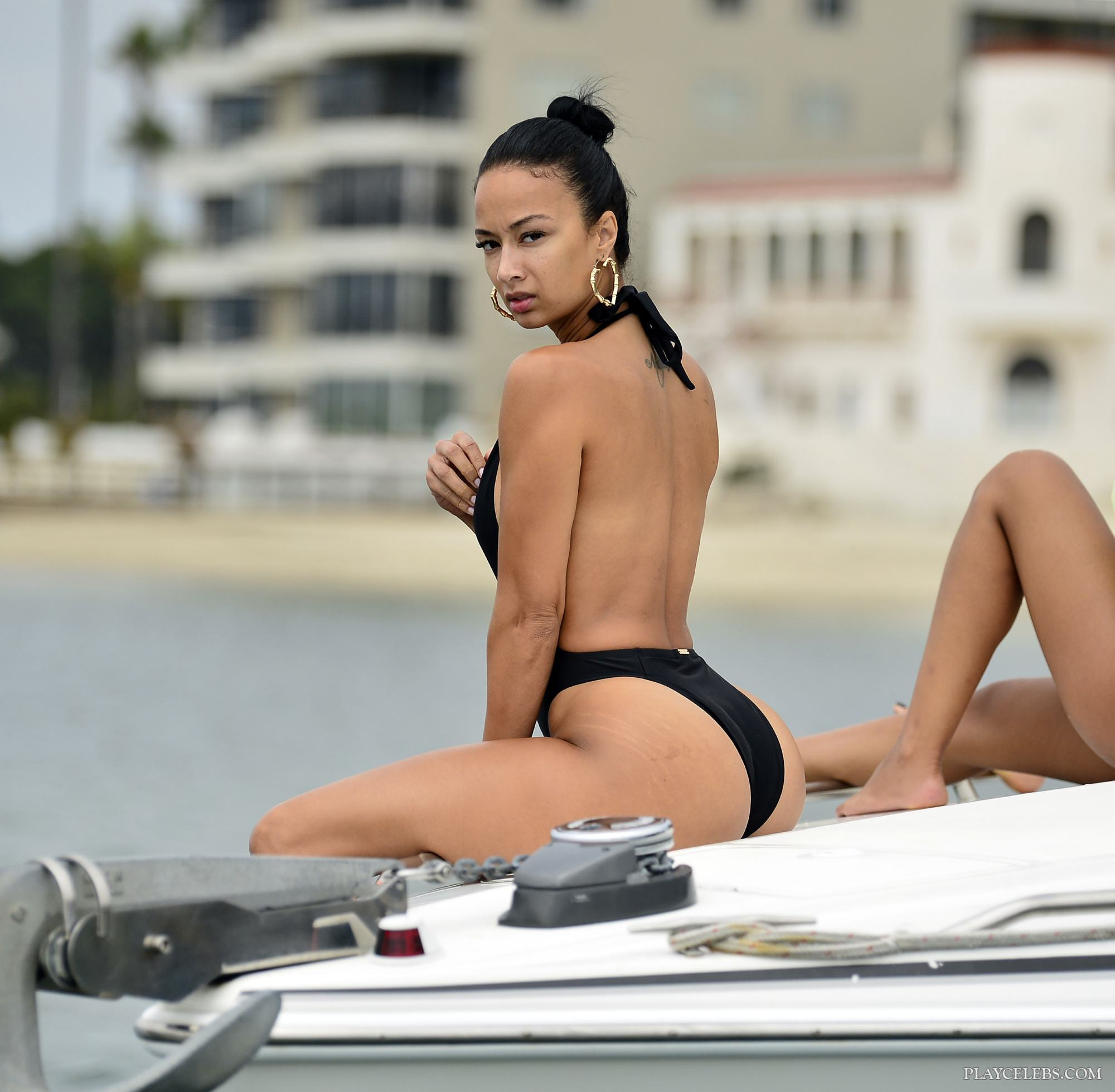 Draya Michele Displays Gorgeous Butt In Tight Swimsuit