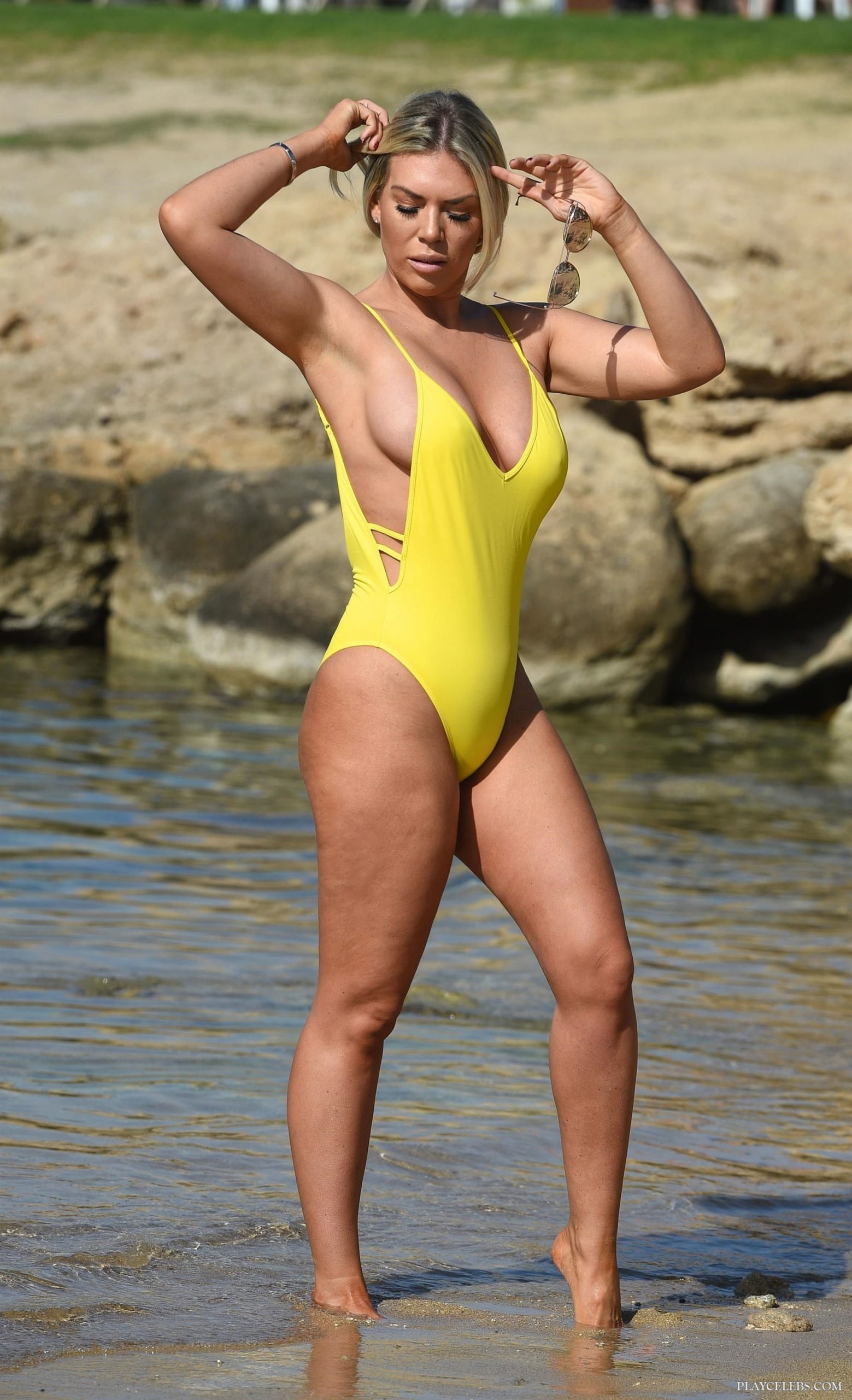 Frankie Essex Displays Her Stunning Body In Yellow Swimsuit
