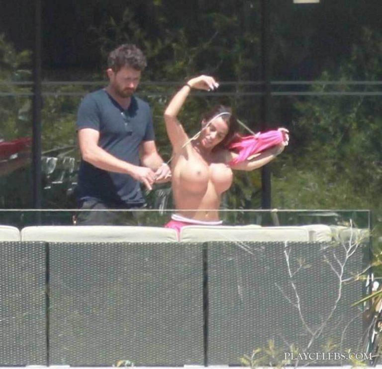 Katie Price Caught Sunbathing Topless