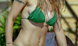 Super Model Michelle Hunziker Sunbathing In Sexy Green Bikini