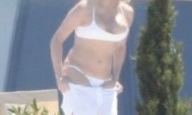Pamela Anderson Nipslip And Bikini Photos