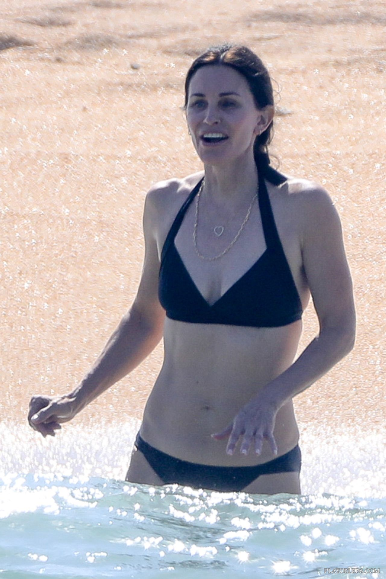 Courteney Cox Caught By Paparazzi In Bikini On A Beach