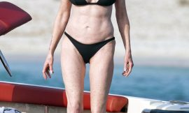Melanie Griffith Caught By Paparazzi In Bikini On A Boach