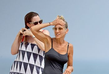 Sarah Jessica Parker Sunbathes In Tight Swimsuit On A