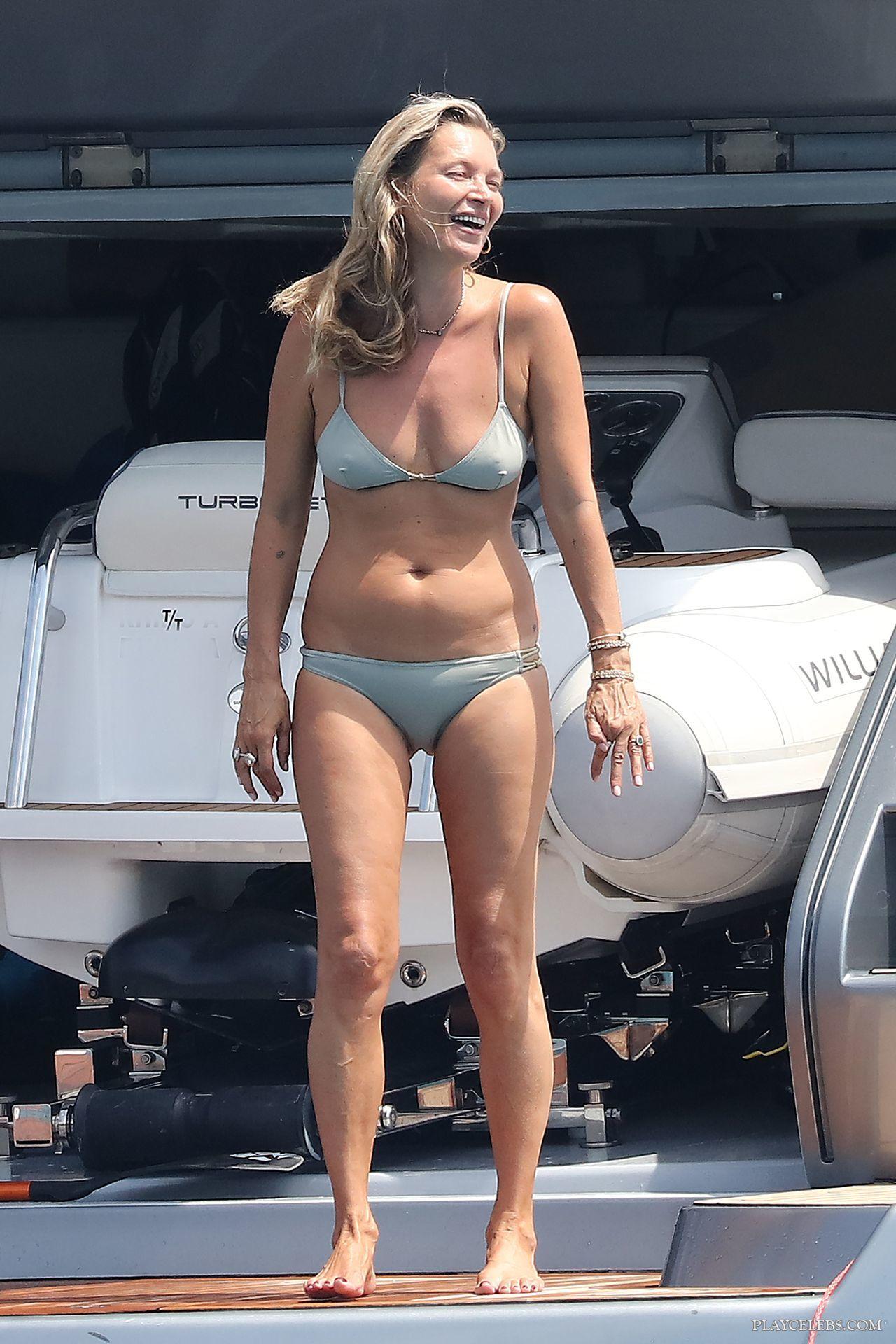 Kate Moss Tanning In Silver Bikini