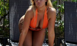 Ellie Young Teasing In Sexy And Tight Swimsuit