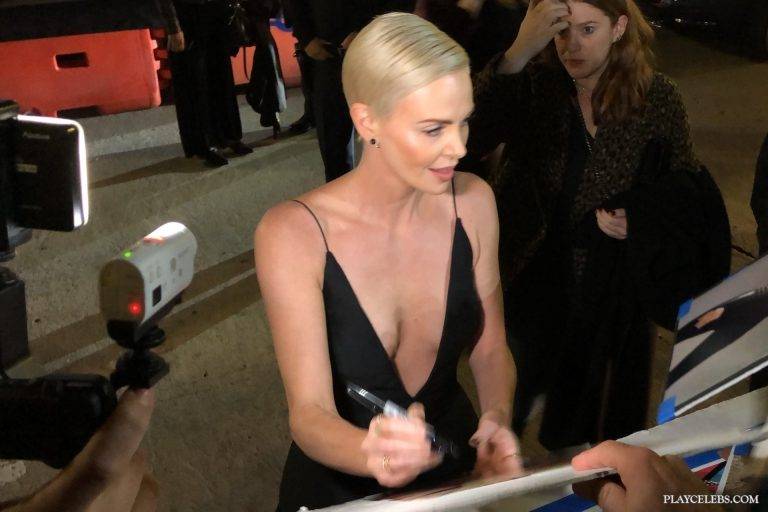 Hollywood Star Charlize Theron Amazing Cleavage And Sexy Photos