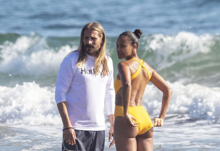 Zoe Saldana Relaxing In Tight Swimsuit On A Beach