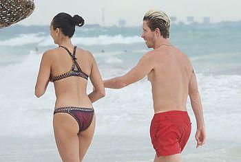 Nina Dobrev topless beach