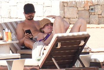 Katy Perry sunbathing