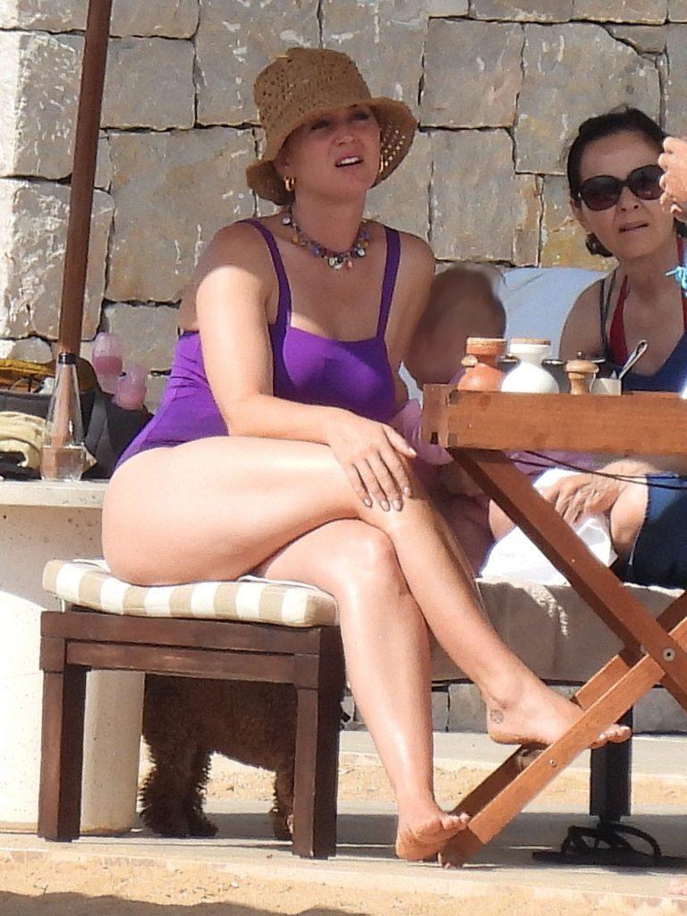 Katy Perry Sunbathing in Swimsuit On A Beach