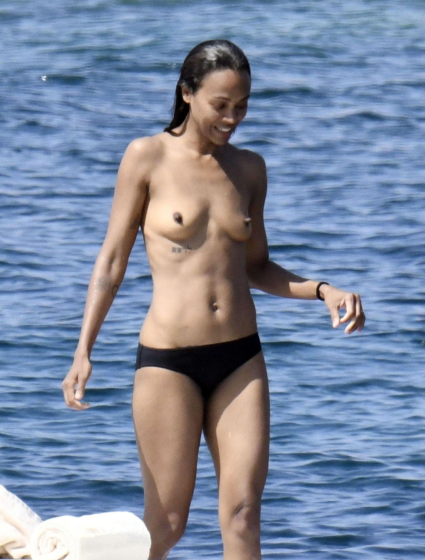 Zoe Saldana Caught By Paparazzi Topless
